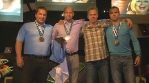 Eesti koondis: vasakult Andres Olesk, Taavi Ehrpais, Sulev Tooming ja juunior Jarro Mihkelson. Foto: Eesti Metsaselts